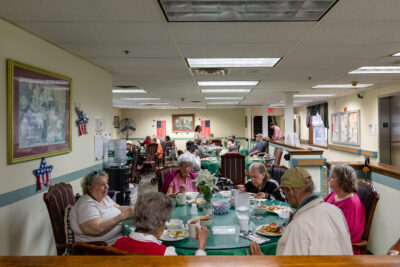 Photo of residents having a meal in the dining room