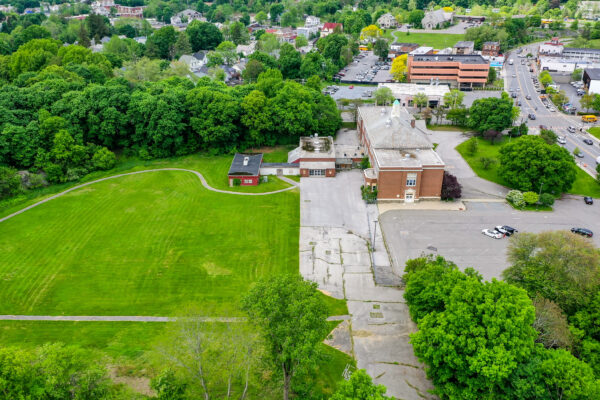 Aerial view of side of Raymond Ave School building